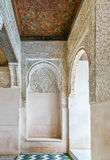 Arch with arabesque in Alhambra, Spain. Arch with stone relief with arabesques in Alhambra palace, Spain Stock Photo
