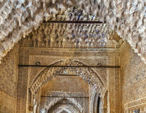 Arch with arabesque in Alhambra, Spain. Arch with stone relief with arabesques in Alhambra palace, Spain Royalty Free Stock Photography