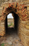 Arch. The arched roof of the passageway in the wall of the fortress Stock Photos