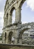 Arch of the Arena in the city of Pula, Croatia. Arch of the Arena with ruins ,left side of the Arena in the city of Pula, Croatia Stock Images