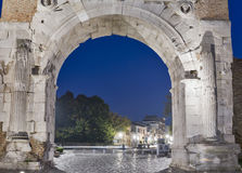 Arch of Augustus at night in Rimini, Italy. Ancient romanesque gate of the city - historical landmark, the most ancient roman arch that still stands intact Stock Images