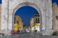 Arch of Augustus at night in Rimini, Italy. Arch of Augustus and night Corso d`Augusto Street in Rimini, Italy. Ancient romanesque gate of the city - historical Royalty Free Stock Image
