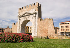 Arch of Augustus in Rimini. Built in 27 BC, it is the most ancient roman arch that still stands intact. The Ghibellines merlons at the top of the arch were Royalty Free Stock Photos