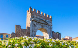 Arch of Augustus in Rimini, historical italian landmark. Arch of Augustus in Rimini, Italy. Ancient romanesque gate of the city Stock Image