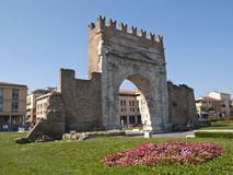 Arch of Augustus in Rimini. Italy. Built in 27 BC, it is the most ancient roman arch that still stands intact. The Ghibellines merlons at the top of the arch Royalty Free Stock Image