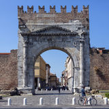Arch of Augustus - Rimini - Italy. The Roman Arch of Augustus, built in 27 BC. Merlons crenellation were added to the top in the Middle Ages. It was restored in Stock Photography