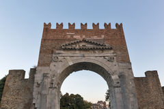 Arch of Augustus at sunset in Rimini, Italy. Ancient romanesque gate of the city - historical landmark, the most ancient roman arch that still stands intact Stock Images