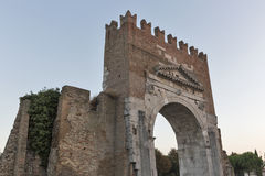 Arch of Augustus at sunset in Rimini, Italy. Ancient romanesque gate of the city - historical landmark, the most ancient roman arch that still stands intact Stock Photo