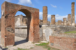 Arch of Augustus and Temple of Jupiter, Pompeii. The triumphal arch of Augustus and Temple of Jupiter, Pompeii, Italy Stock Image