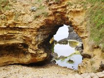 An arch of the Australian Grotto. The grotto is a sinkhole geological formation found on the Great Ocean Road outside Port Campbell in Victoria in  Australia Stock Photo