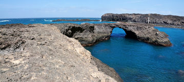 Arch in Baia. Baia a natural oasis made of a volcanic arch over a clear blue water lagoon serves as one of the natural wonders of the the island of Fogo, part of Royalty Free Stock Photo