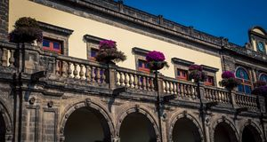 Arch and balcony in mexico city. Arch and balcony with a railing  in mexico city Stock Images