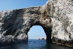 Arch ballestas. A natural arch at ballestas Island in peru Stock Photo