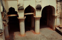 Arch with basement pillars of the thanjavur maratha palace. The Thanjavur Maratha Palace Complex, known locally as Aranmanai, is the official residence of the royalty free stock photos
