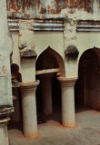 Arch with basement pillars of the thanjavur maratha palace. The Thanjavur Maratha Palace Complex, known locally as Aranmanai, is the official residence of the royalty free stock images