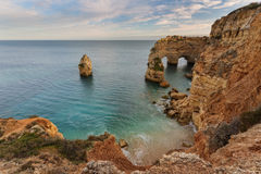 Arch Beach Marinha, Portugal. The waves on the shore Stock Images
