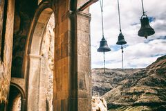 Arch bells view from Church and chapel in Vardzia cave city-monastery in the Erusheti Mountain, Georgia. Arch bells view from Church and chapel Vardzia cave city Royalty Free Stock Photo