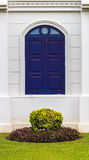 Arch Blue Window with Small Garden. Arch Blue Window of Building with Small Garden Stock Photos