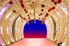 Arch bokeh gold, Blurred arch Bokeh golden light background night arch of lamps LED colorful yellow shine, Backdrop arch door stock photos