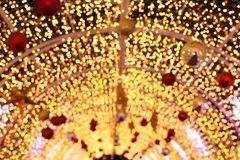 Arch Bokeh gold yellow colorful of merry christmas, Happy new year bokeh lighting shine on night background, Bokeh glitter light. The Arch Bokeh gold yellow Royalty Free Stock Photos