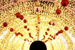 Arch Bokeh gold yellow colorful of merry christmas, Happy new year bokeh lighting shine on night background, Bokeh glitter light. The Arch Bokeh gold yellow Stock Photo