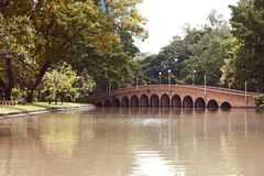 Arch brick bridge over the lake at JatujakChatuchak public city park. In Bangkok,Thailand Royalty Free Stock Images