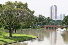 Arch brick bridge over the lake at JatujakChatuchak public city park. In Bangkok,Thailand Stock Photo