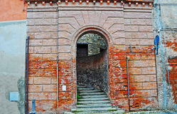 Arch in a brick wall in Brisighella Royalty Free Stock Photo