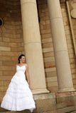 Arch Bride 1. A bride standing next to a chapel Royalty Free Stock Photo