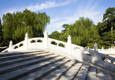 Arch bridge. White marble arch bridge in Chinese garden Royalty Free Stock Photography