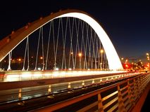 Arch and Bridge. Oblatas bridge in Pamplona, illuminated at night and with car light trails Royalty Free Stock Image