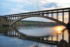 Arch bridge. Arched bridge at sunset on the Dnieper River Stock Photo