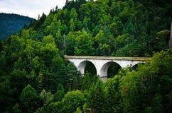 Arch bridge. Solid bridge over the mountain Stock Images
