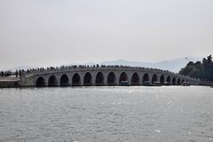 17-Arch Bridge across the Kunming Lake on the grounds of The Summer Palace in Beijing. The entire bridge is 150 metres long and eight metres wide Royalty Free Stock Photo
