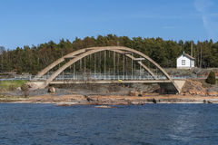 Arch bridge across the strait. Between the islands of the Aland Royalty Free Stock Images