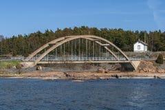 Arch bridge across the strait Royalty Free Stock Images