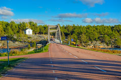 Arch bridge across the strait between the islands of the Aland. Autumn sunset view on arch bridge across the Strait of the Baltic Sea in Bomarsund, Aland. Local Royalty Free Stock Images
