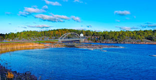 Arch bridge across the strait between the islands of the Aland. View of The Baltic Sea, a strait and a arch bridge across in Bomarsund, Aland. Local Museum in Stock Images