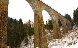 Arch Bridge in the Black Forest. An interesting pattern of diminishing arches formed by this brick bridge in the Ravennaschlucht Gorge in the German Black Forest Royalty Free Stock Photo