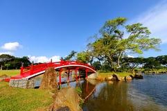 Arch bridge in Chinese garden. Bright red arch bridge in Chinese garden Royalty Free Stock Image