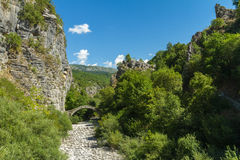 Arch bridge at the entrance to Kipoi. Kipoi is a small village located in Zagoria, Greece Stock Image