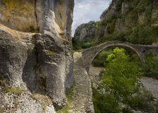 Arch bridge, Epirus, Greece. The bridge Noutsou or Kokkori crosses the Vikos River, between the villages of Kipoi and Koukouli. It was built in 1750. Greece Royalty Free Stock Images