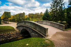 Arch bridge and fish channel in catherine park in autumn. Pushkin, Russia Stock Images
