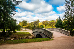 Arch bridge and fish channel in catherine park in autumn. Pushkin, Russia Stock Photos