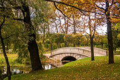Arch bridge and fish channel in catherine park in autumn. Pushkin, Russia Royalty Free Stock Photos