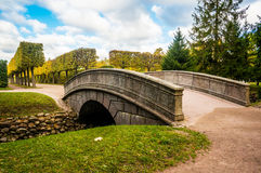 Arch bridge and fish channel in catherine park in autumn. Pushkin, Russia Royalty Free Stock Photo