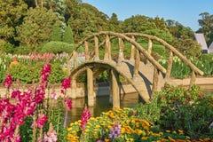 Arch bridge. Arch bridge in flower garden Stock Images