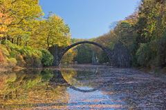 Arch Bridge in Kromlau, Saxony, Germany. Autumn in Park. Rakotz bridge in Kromlau Royalty Free Stock Photo