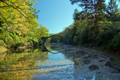 Arch Bridge in Kromlau, Saxony, Germany. Autumn in Park Stock Photos
