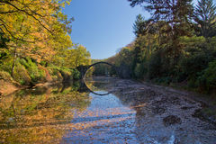 Arch Bridge in Kromlau, Saxony, Germany. Autumn in Park Stock Images